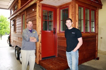 Mr. Ackerman and Mr. Engel at the front door of the completed tiny house.